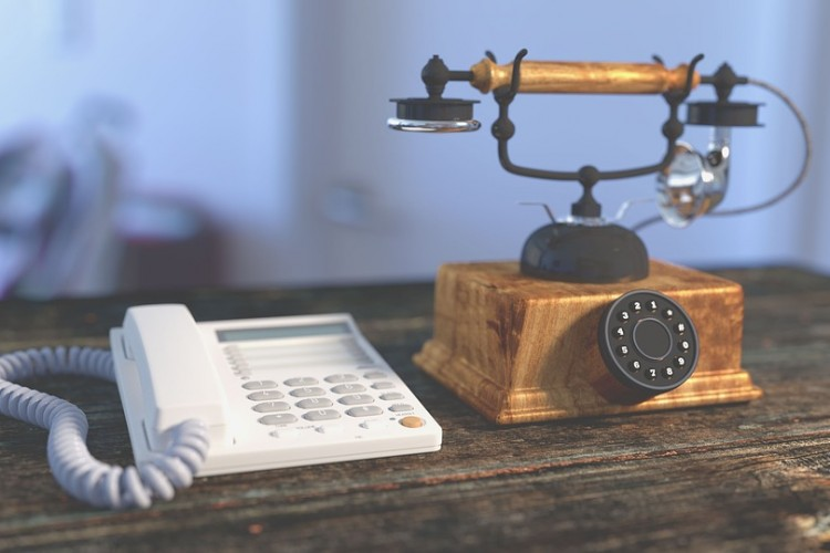 modern and a vintage telephone
